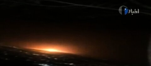 An image grab from footage obtained from Iranian State TV IRIB on June 26, 2020, shows an orange light resulting from what the defence ministry said was a gas tank explosion that rocked Tehran overnight